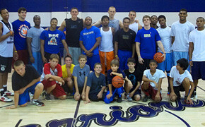 Men's basketball team hosts boys school
