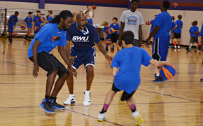 Young players learn basketball fundamentals