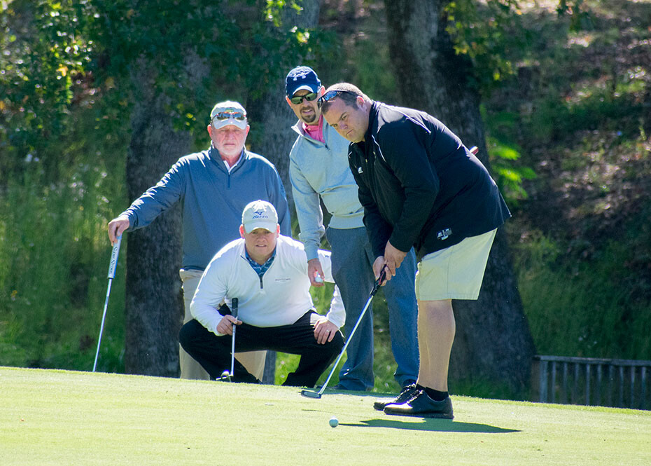 Josh Howard Hits A Putt As Marty Atcheson Left And His Sons Joe John Look On During The Annual PB Wood Golf Tournament Oct 2 At