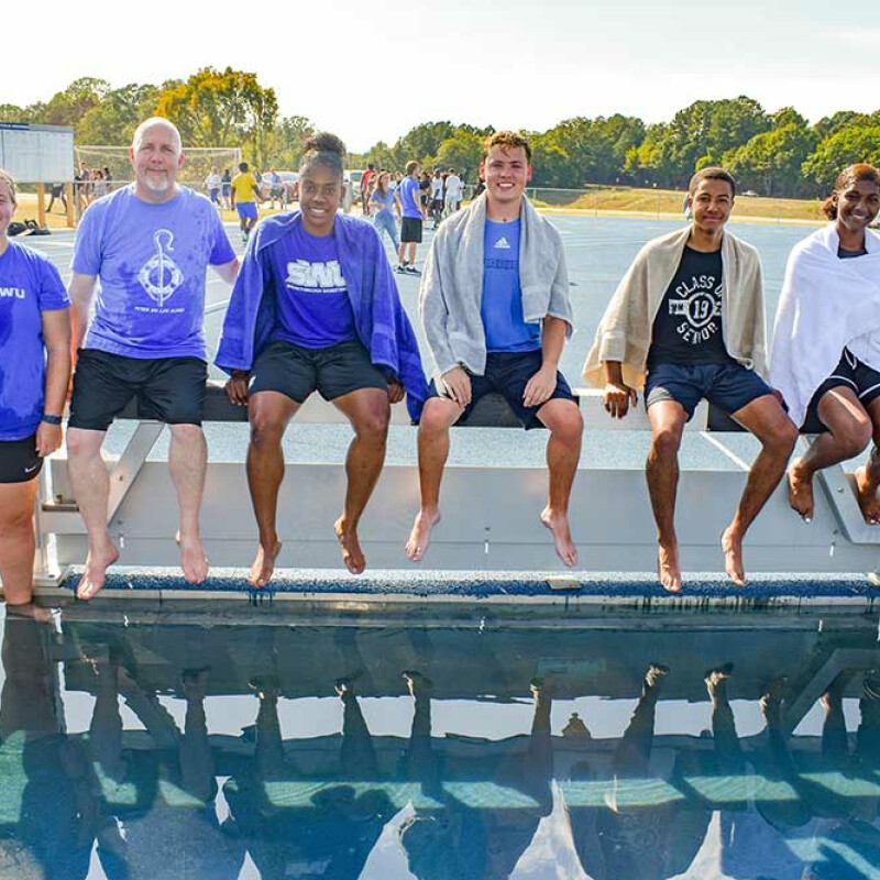 Students baptized at tracks steeplechase pit